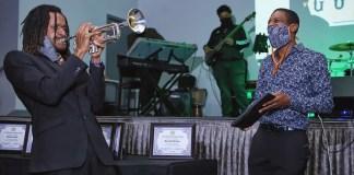 Black 40 Under 40 Founder Shawntaz Crawford (right) enjoying the music of trumpeter Fredrick Weathersby. (Photo by: Deshun Smith)