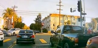 A Honda HRV that was hit by another vehicle, jumped the curb and landed on the sidewalk, killing a toddler in a stroller and injuring a nearby pedestrian, in the North Hills area of Los Angeles, California, on Oct. 17. (Los Angeles Police Department/Zenger)