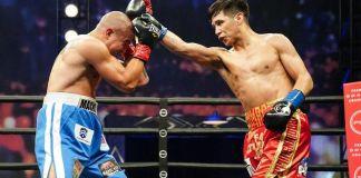 Omar Juarez throws a partially blocked right hand at Elias Araujo's head in a bout Juarez won on April 17. (Sean Michael Ham/TGB Promotions)