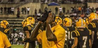 Marcus Washington working the sidelines as a coach at his alma mater, Fort Bend Marshall High School in Texas. (Courtesy of Marcus Washington)