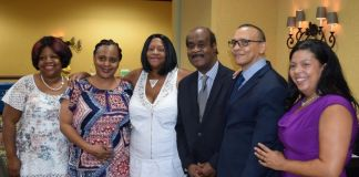 """Larry Simmons (second from right) with Women Who Care Ministries board members (from left) Lorna Green, Shannon Matthews, Judith Clarke, Montgomery County Executive Isiah Leggett and Victoria Nobles. """"[Simmons'] commitment to helping others overcome challenging areas of their lives is unparalleled,"""" said Executive Director Clarke. (Courtesy of Larry Simmons)"""