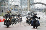 On Thursday, Aug. 10 Harley-Davidson and the Milwaukee Bucks announce global agreement as Bill Davidson and the team's mascot, Bango, ride in to reveal the partnership at the Harley-Davidson Museum in Milwaukee. The sponsorship unites two of the world's favorite sports and reaches new, young adult audiences across the U.S. and around the world in over 200 countries and territories. (Darren Hauck/AP Images for Harley-Davidson)