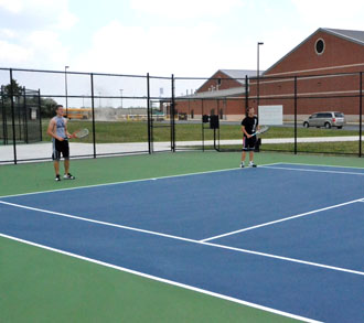 Two players use the Van Wert County Foundation Tennis Complex behind the Van Wert High School-Middle School Complex. (VW independent file photo)
