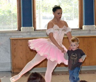 A ballerina from the Fort Wayne (Ind.) Ballet dances with a young local boy as part of the Brumback Library's Summer Reading Program in 2012. (VW independent file photo)