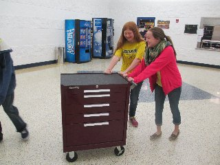 Lana Carey and Shiann Craft take the mobile store to the lower elementary grades in another wing of the building. (Photo submitted.)