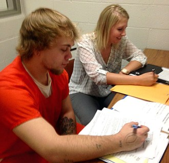Summer bailiff intern Claire White (right) works on life skills with a Van Wert County Correctional Facility inmate. (photo submitted)