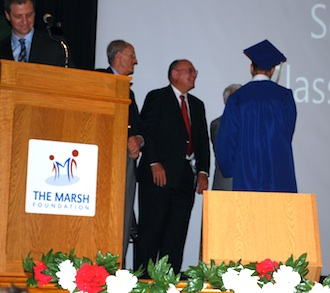 A graduate receives his diploma and is congratulated by The Marsh Foundation Trustees. (Photo submitted.)