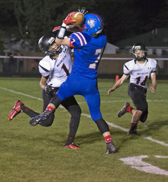 Crestview's Grant Schlagbaum (7) catches a Drew Kline pass on his helmet for a touchdown during Friday's game against Spencerville. (Bob Barnes/Van Wert independent)