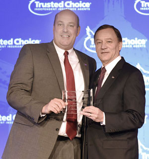 "Central's Vice President of Marketing Tim Rauch (left) accepts the Best Practices Award from Robert Rusbuldt, Big ""I"" president and CEO. (photo submitted)"