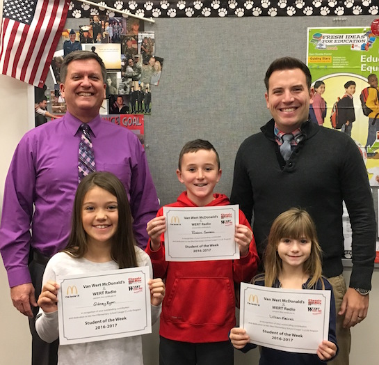"""Forgiving"" is the Van Wert Elementary School Word of the Week!  Congratulations to the Van Wert Elementary School Students chosen for the Word of the Week award!  Pictured with Mr. Gehres, Principal, and Mr. Krogman, Assistant Principal are Lillian, grade 2; Sidney, grade 3; and Robbie, grade 4. Each child received a free Mighty Kids Meal from our local McDonalds and a certificate from WERT Radio. (Photo submitted.)"