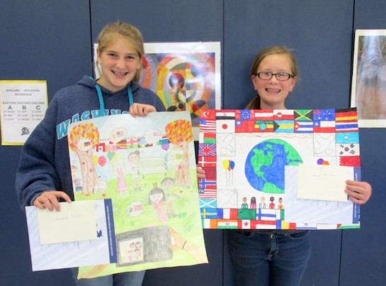 """These sixth grade Lincolnview students participated in the Lions International Peace Post Contest. This contest is held every year and encourages children 11-13, to creatively express what peace means to them. The 2016-2017 contest theme was """"A Celebration of Peace.""""  Morgan Anspach placed first and Cheyenne Pohlman placed second at the local level. The first place winner's artwork will move on to be judged at the district level.  (Photo submitted.)"""