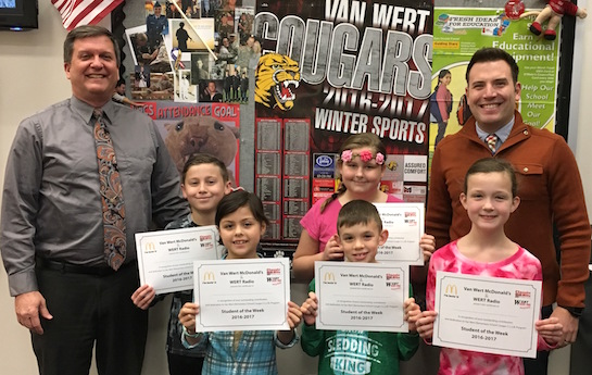 Congratulations to the Van Wert Elementary School students chosen for the Word of the Week award!  Pictured with Mr. Gehres, Principal, and Mr. Krogman, Assistant Principal, are students recognized for doing exceptional work.  Award winners this week are Jayden, grade 1; Izabella, grade 2; Callie, grade 3; Nate, grade 4; and Izabel, grade 5.  Each child received a free Mighty Kids Meal from our local McDonalds, a free taco from our local Taco Bell, and a certificate from WERT Radio. (Photo submitted.)
