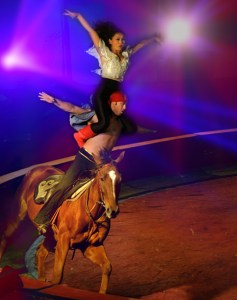 Nur Jamal, top, and Ulanbek Kambarov, bottom, ride a horse during a performance of Jordan's Shrine Circus at the Taylor County Expo Center, Reporter-News photo by Nellie Doneva