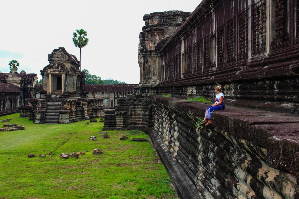 Sitting on Angkor Wat • Remarkable Tips to Make Traveling to Cambodia Easier   The Wanderful Me