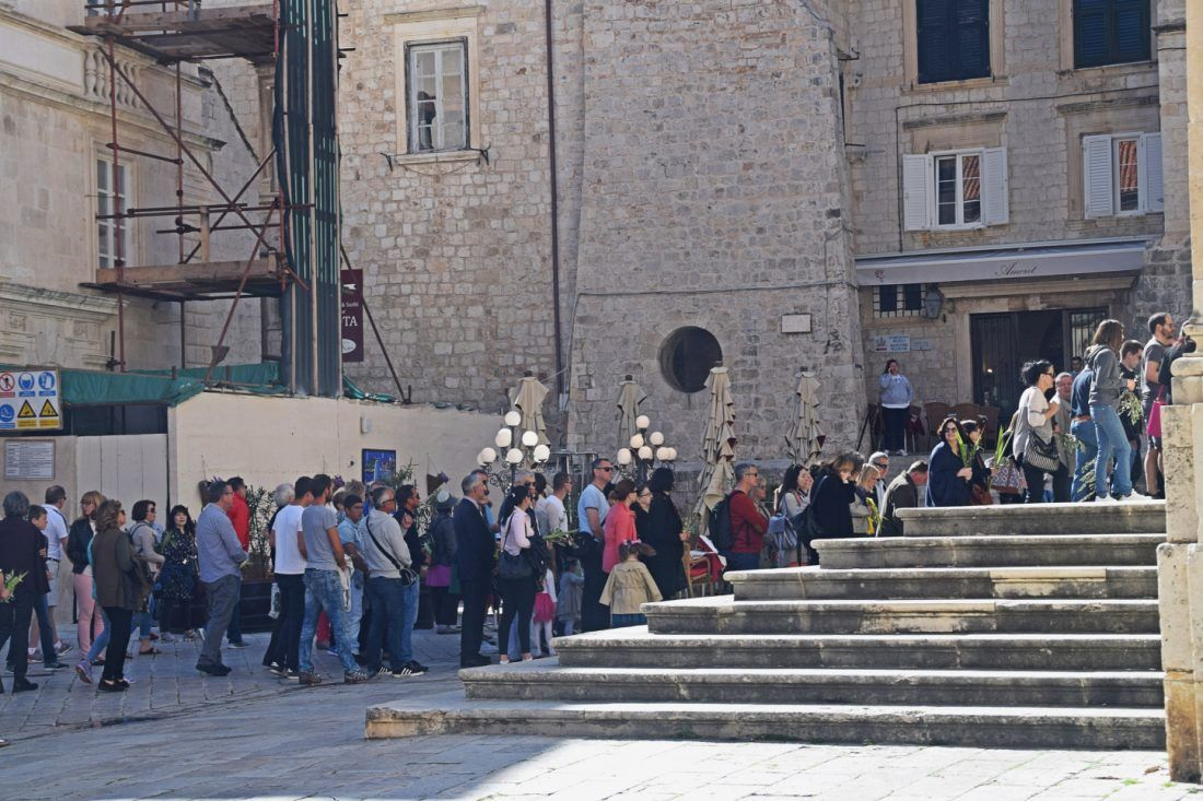 People lining up to enter the Cathedral on Palm Sunday, Dubrovnik, Croatia.  You can just about see that the people on the steps have palms and olive branches.