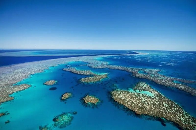 The incredible landscape of the Great Barrier Reef photographed from a helicopter.