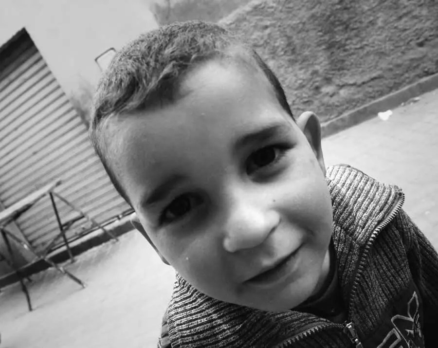 Marrakech, Morocco: While riding a bicycle around the city I got a punctured tyre in a little alley. This little guy and his brothers were quick to help out and played soccer with me until his older brother fixed up the tyre...having a camera here made the moment extra special!