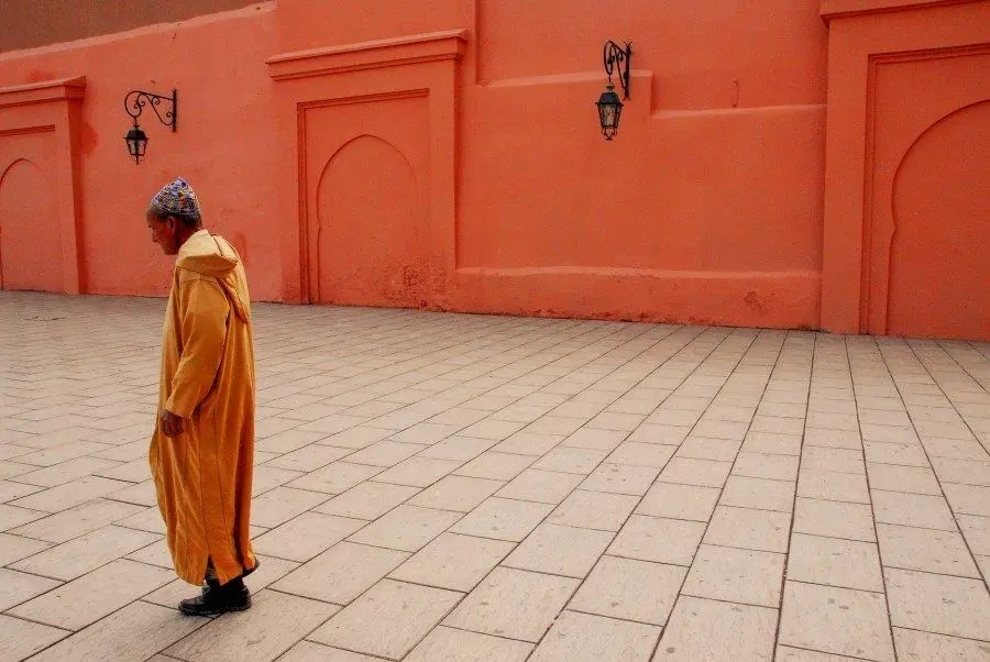 Marrakech, Morocco: Perhaps the favourite travel portrait I've taken, and also one of my first. In Marrakech the colours and culture ooze with photography possibilities. In order to remain culturally sensitive I was attempting to photograph people walking past this wall at the Koutoubia Mosque when this man walked past in his orange jalaba.