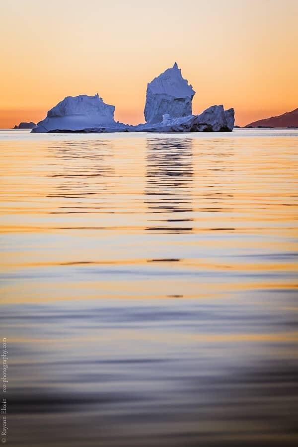 Iceberg and evening light in Uummannaq in West Greenland