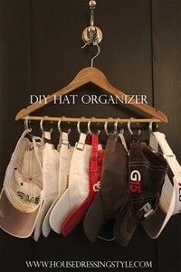 DIY hat organizer using a clothes hanger and shower hooks