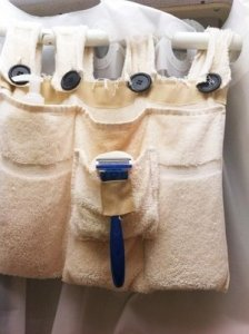 Save space in your RV shower by making a caddy out of towels!
