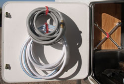 Hang your RV hoses to make extra space in your outside storage