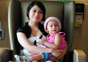 Michelle Arce and Aimee Gomez-Arce await news on Aimee's treatment at Seattle Children's.