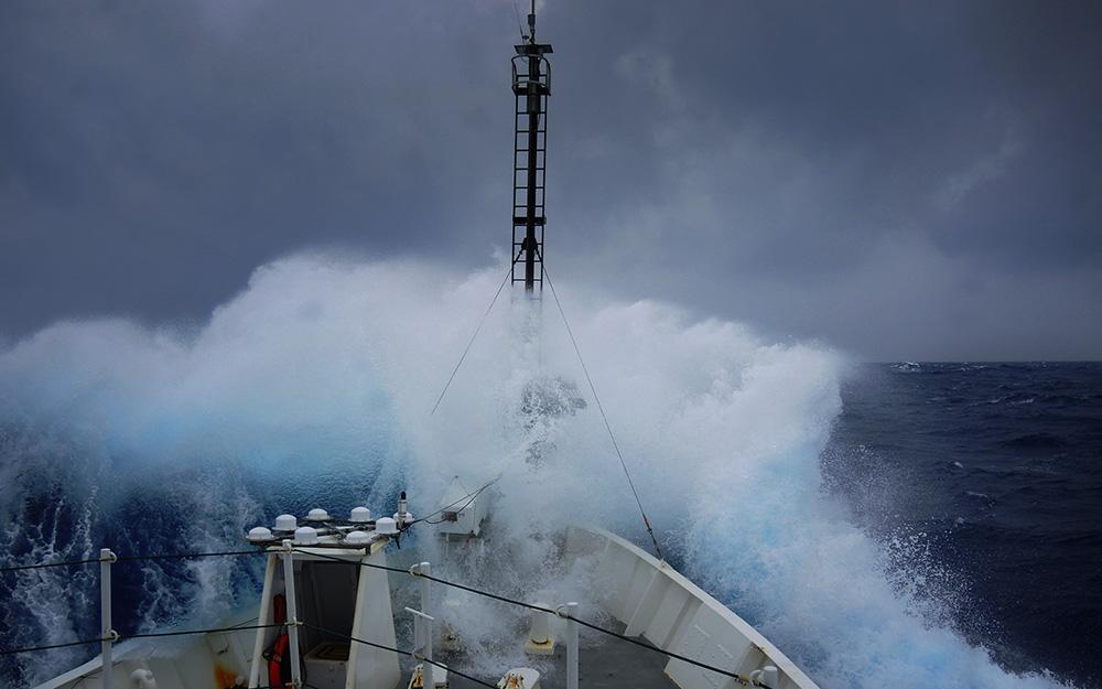 Storm waves crashing over a ship