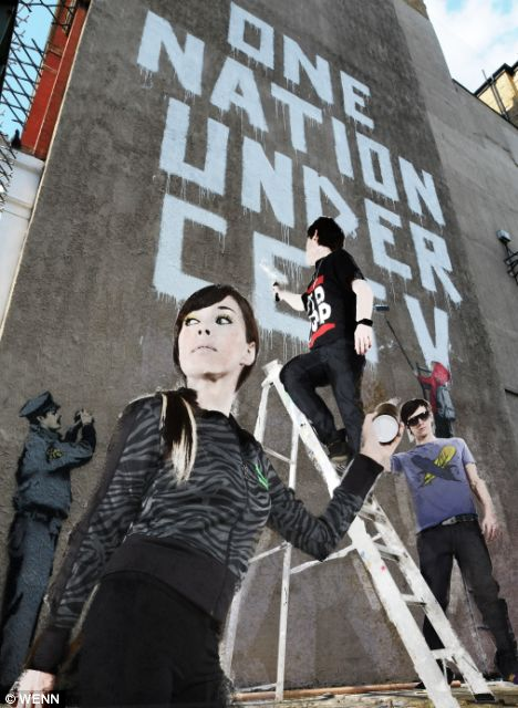 A new Banksy mural 'One Nation Under CCTV' painted next to a CCTV camera at a Post Office yard in the West End. (Image: Dailymail.co.uk)