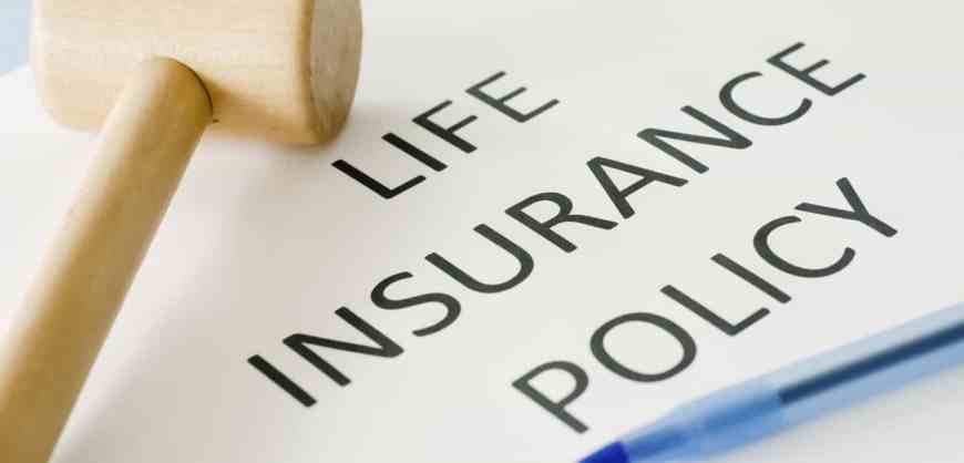 What is surrender value and paid-up value of a life insurance policy ?