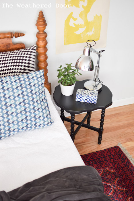 Black side table and Birds Eye Maple Jenny Lind bed frame from theweathereddoor.com