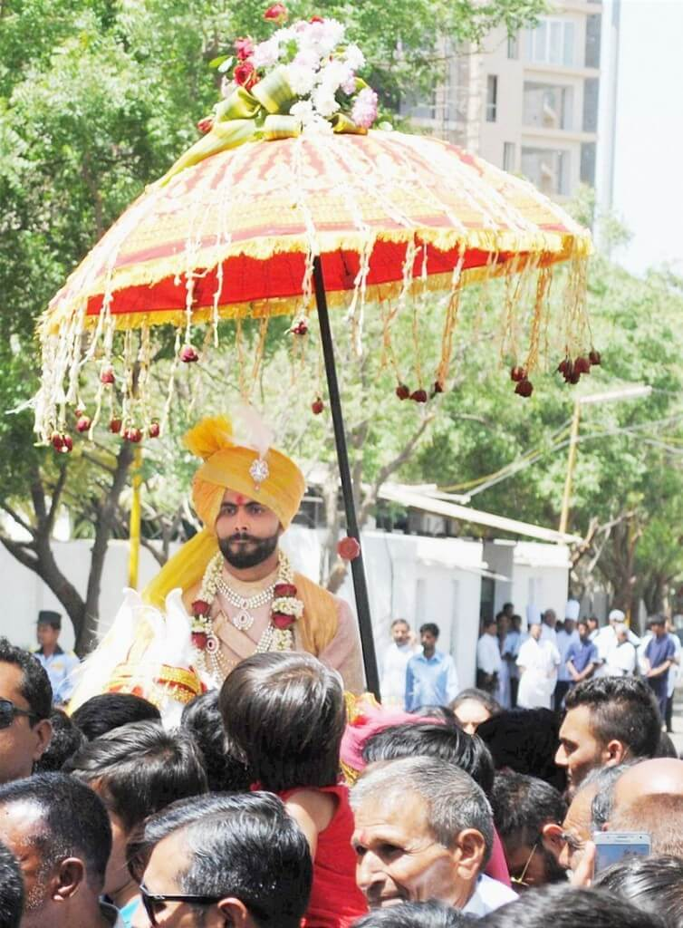 Rajkot: Cricket Ravindra Jadeja during the 'Baarast'procession of his wedding in Rajkot on Saturday. PTI Photo(PTI4_17_2016_000173B)