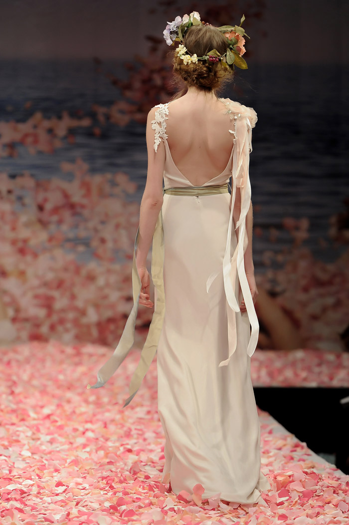 Claire Pettibone 2013 Fall Collection – Maiden. Ivory linen with guipure leaves and jeweled blossom shoulder with green ribbon waist sash. www.theweddingnotebook.com