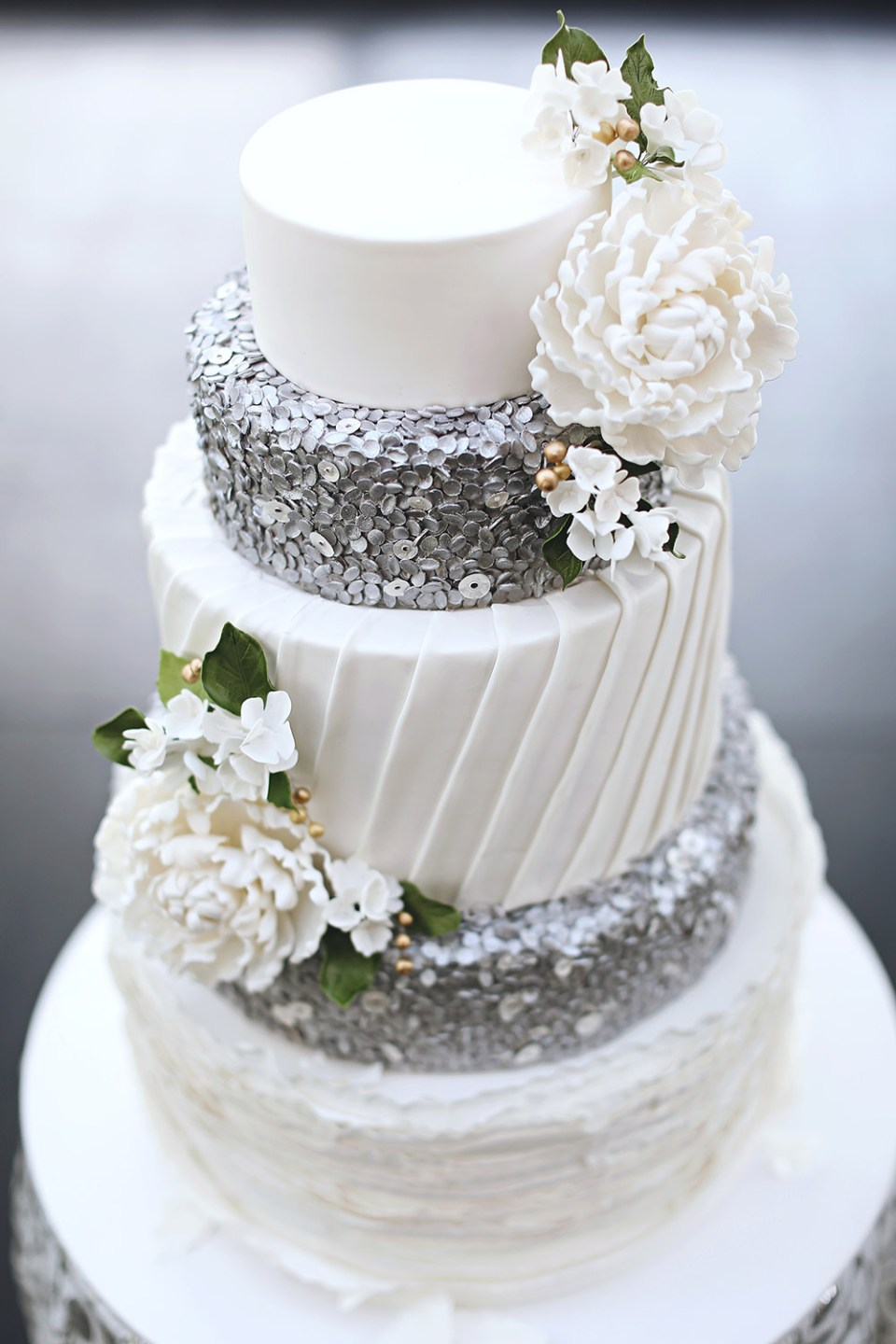 White and silver wedding cake by Miss Shortcakes. Photo by Axioo. www.theweddingnotebook.com
