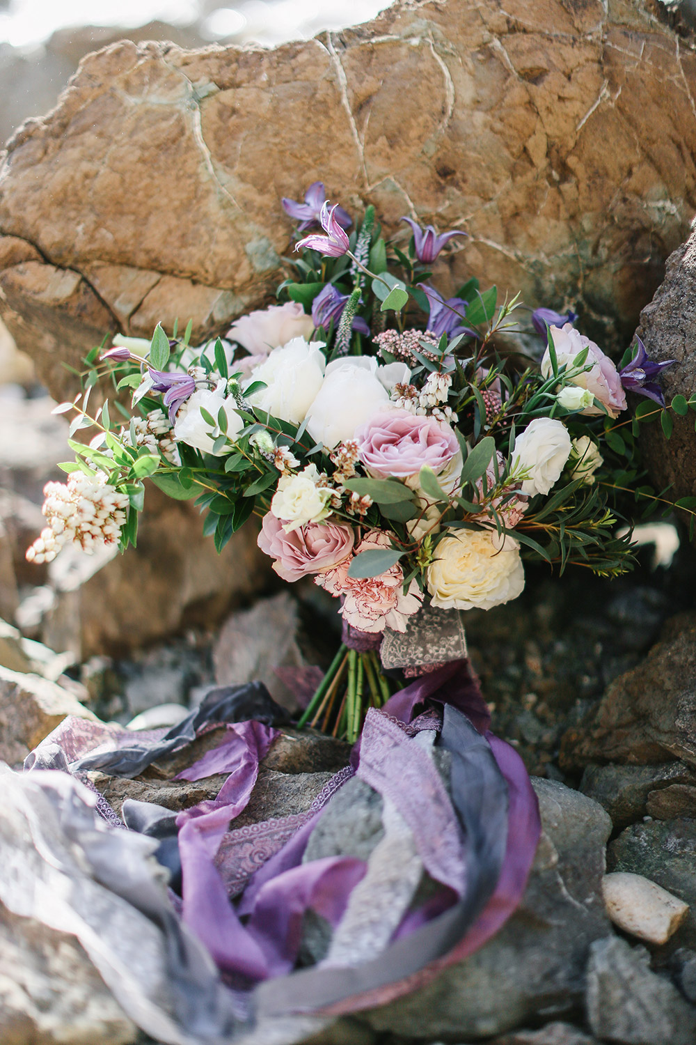 Lilac and lavender bridal bouquet. Photo by Alexander Santi. Styling by JR Weddings. www.theweddingnotebook.com