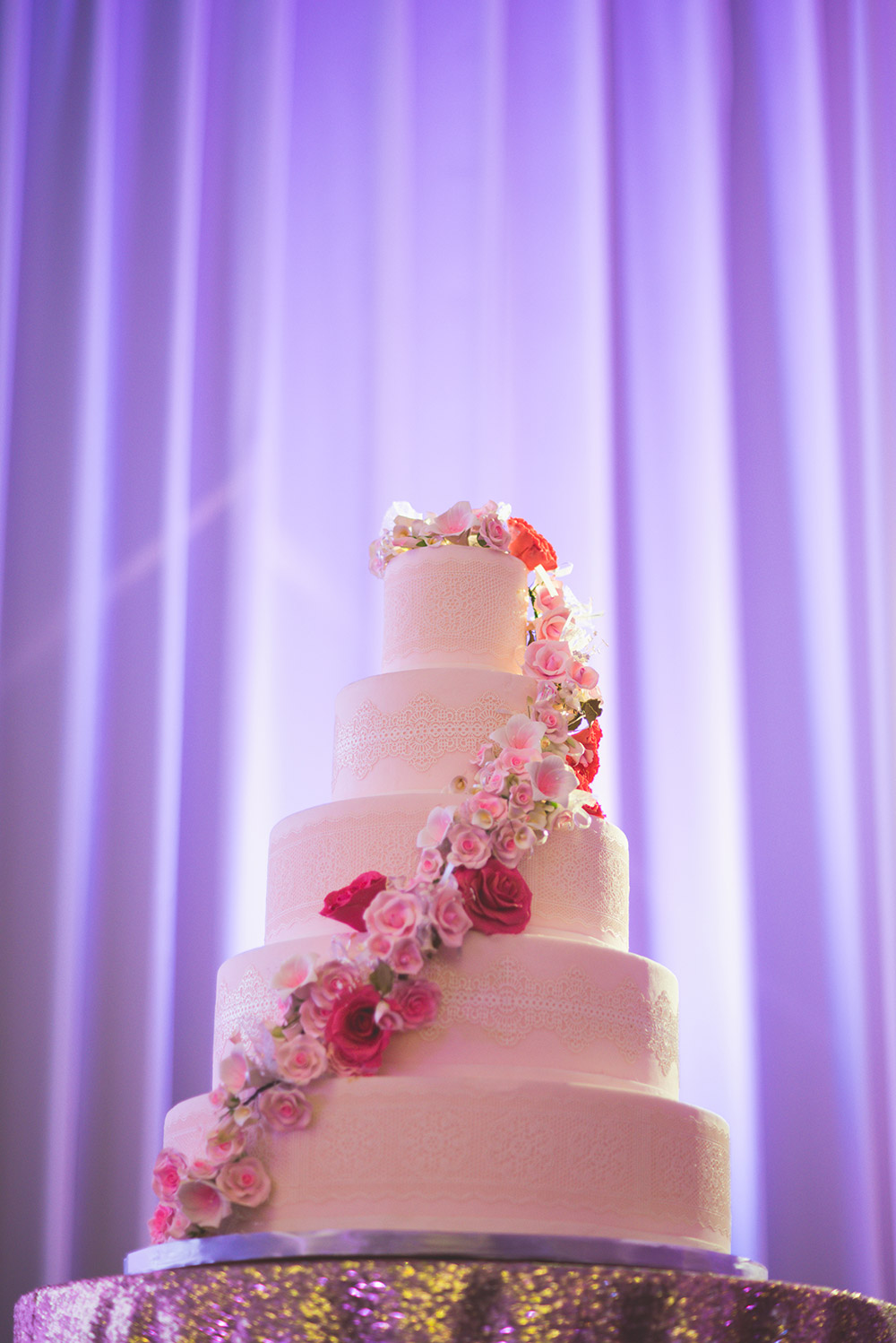 White floral wedding cake. Jon Low Photography. www.theweddingnotebook.com