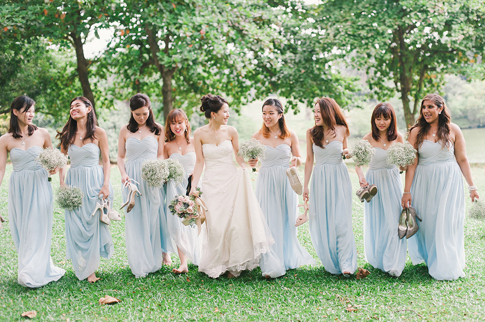 Bridesmaids in pastel blue. Munkeat Photography. www.theweddingnotebook.com