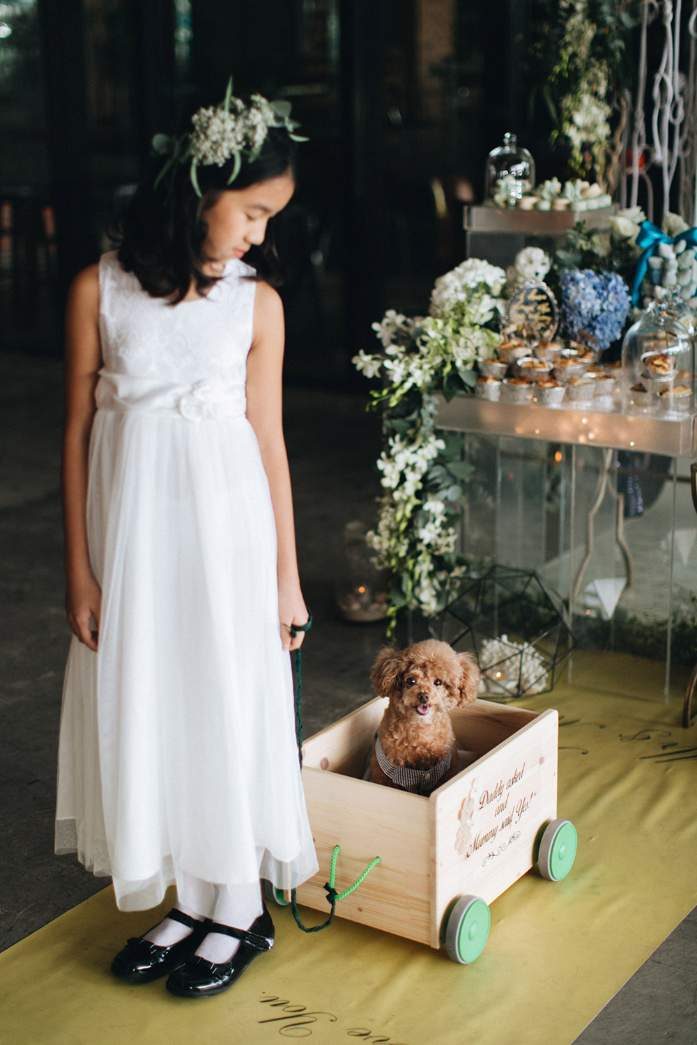 Adorable dog and flowergirl. Photo by Arch and Vow. www.theweddingnotebook.com