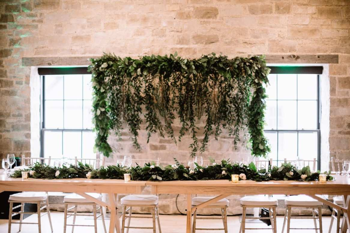 fresh look design greenery wedding head table backdrop