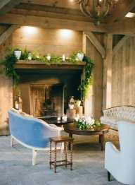 fresh look design wooden mantle with greens and candles wedding