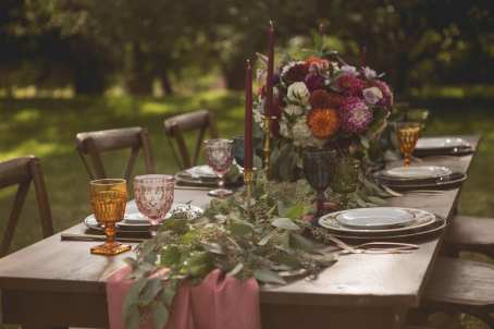 fresh look design long wedding table with pink runner, greenery and flowers