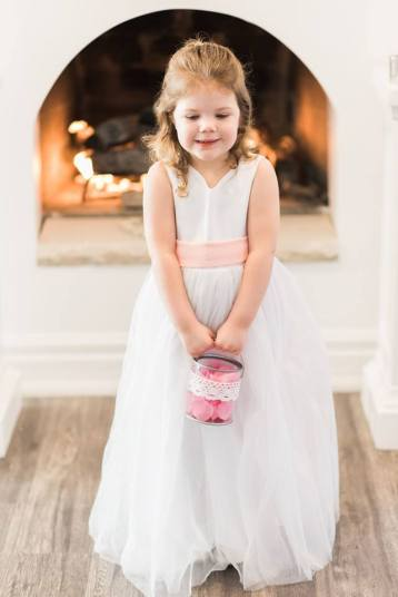BridesMade flowergirl in white dress with peach sash