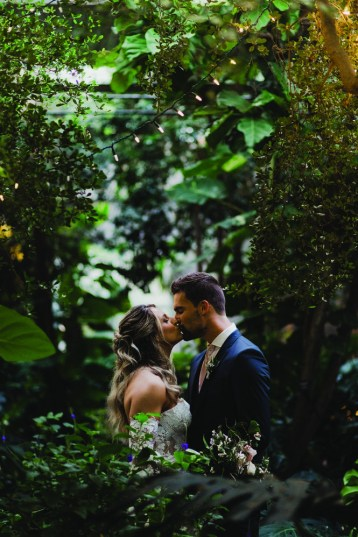 wedding kiss in the tropical garden at cambridge butterfly
