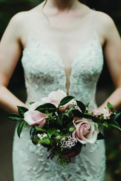 strapless wedding dress and rose bouquet cambridge butterfly