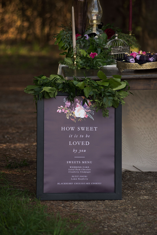 purple sweets menu board with lush greenery on top