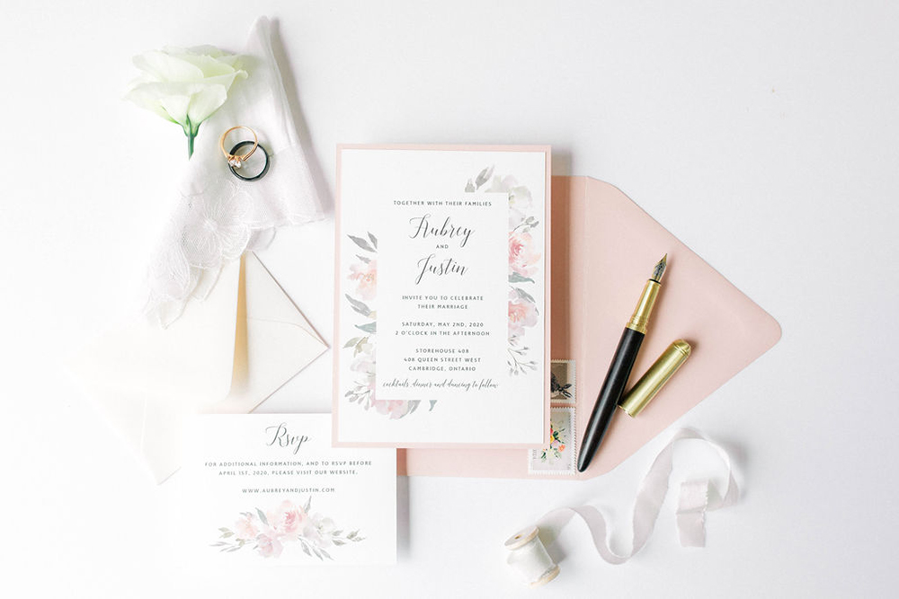 invitation set with blush floral border