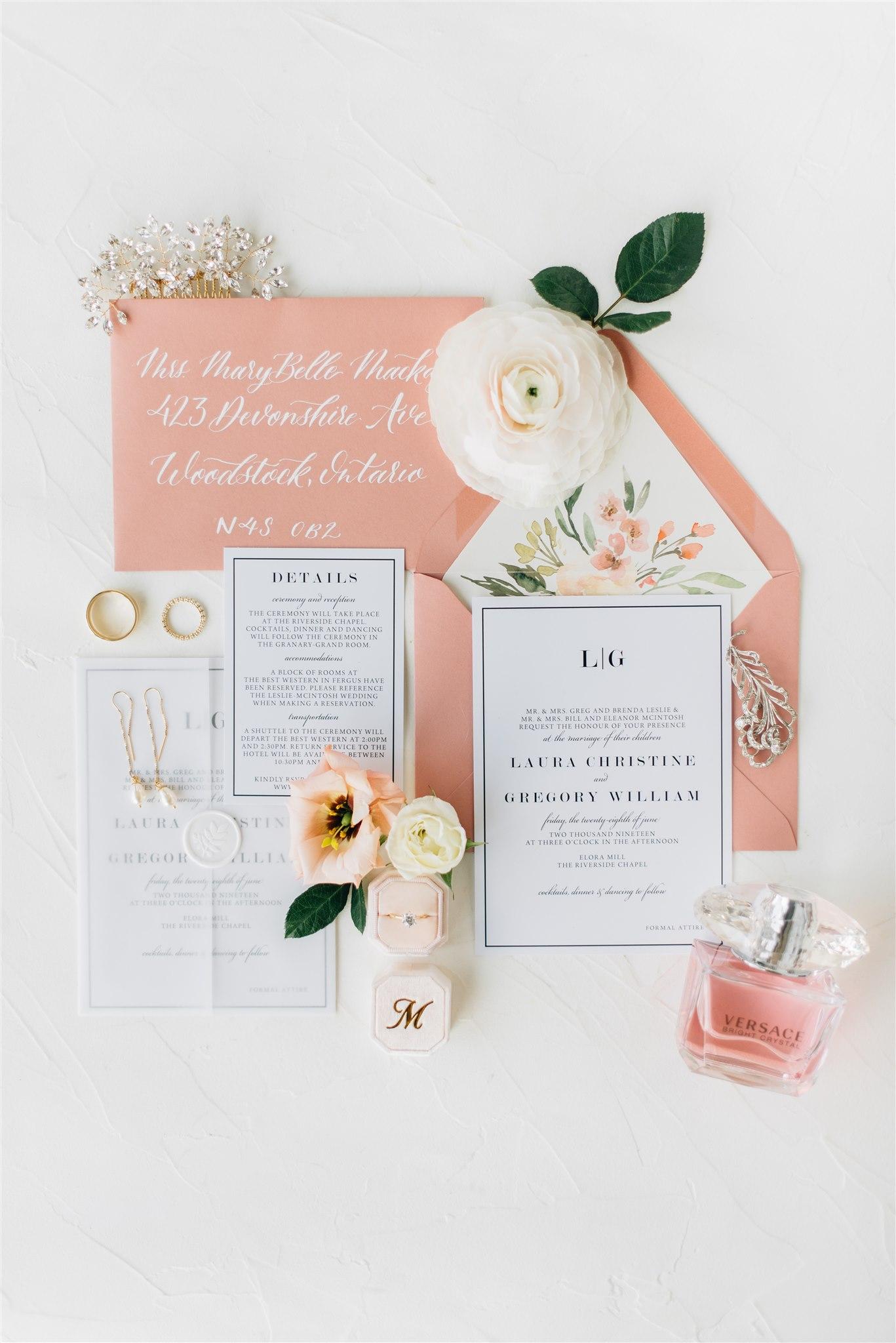 Complete wedding invitation flatlay on wedding day