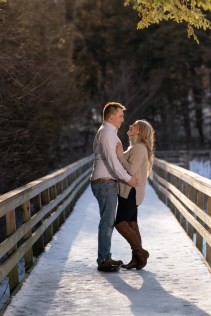 hayley and jason's love story snowy winter engagement photo on a bridge Wedding photography A Nash Photogra