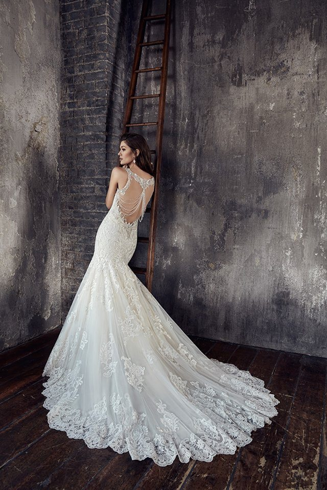 creme couture backless but accented wedding dress