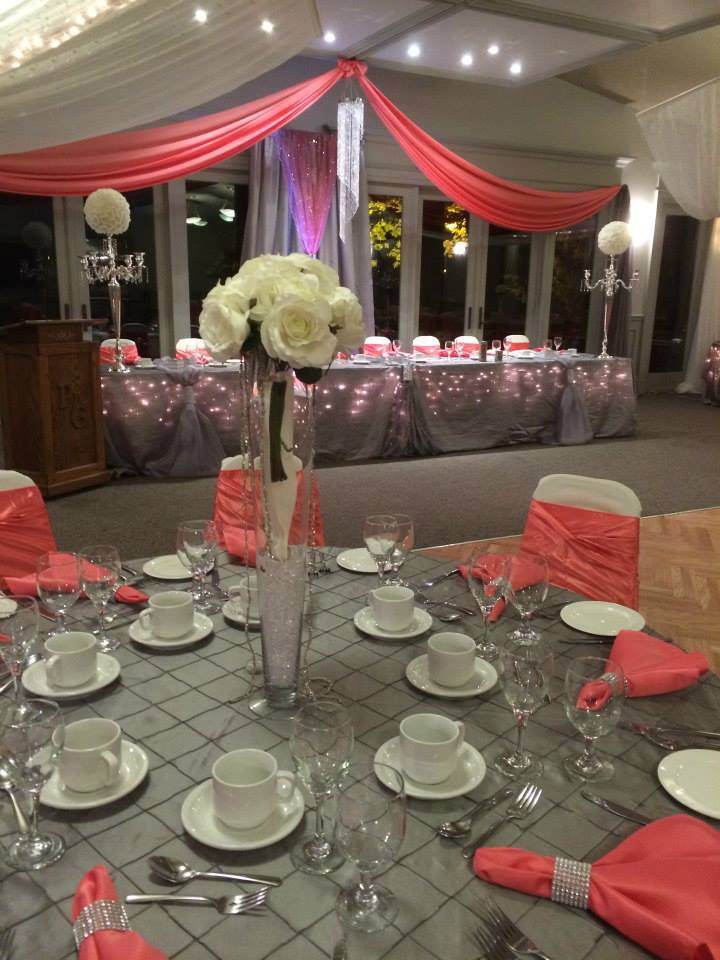 Now & Always grey and pink wedding guest table with tall thin vases of white flowers